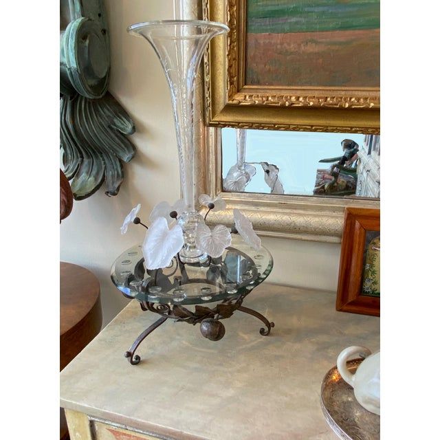 Epergne with etched crystal trumpet rising high above the iron base topped with a crystal plateau and cut crystal leaves...