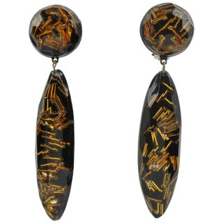 Oversized Black Lucite Long Drop Clip on Earrings With Gilt Beads Inclusions For Sale
