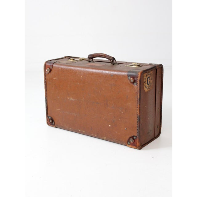 Rustic Vintage Suitcase With Travel Stickers For Sale - Image 3 of 8