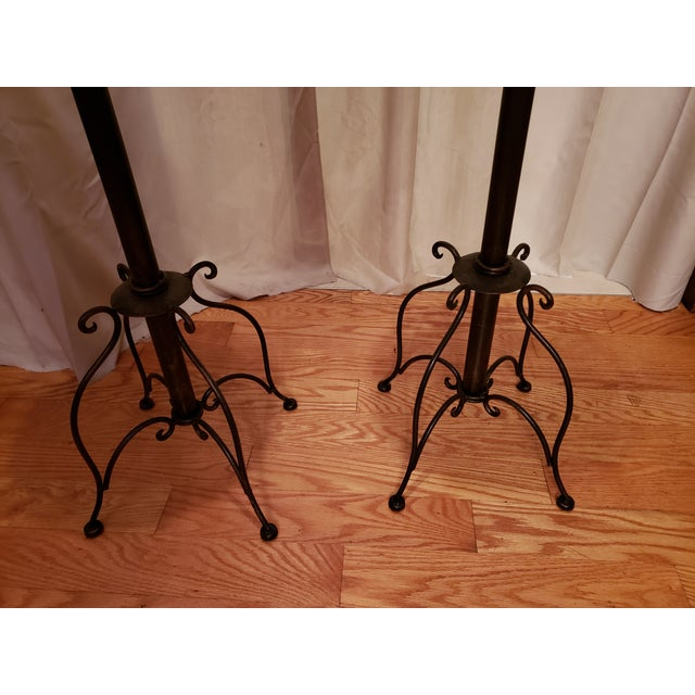 Nice Iron , metal and wicker plant stand with iron rings on either side. 39.5 tall top 12.5 wide legs span 10.5 apart...