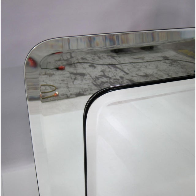 Large Beveled Rectangular Mirror with Radiused Corners framed by a larger mirror. Back panel has inset hardware for...