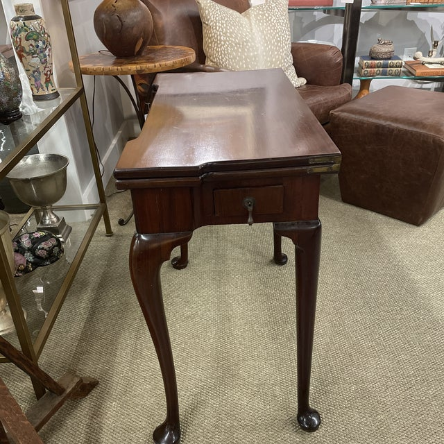 Out of a Greenwich Ct estate. a wonderful Queen Anne game table with green moire silk top charming little piece that can...