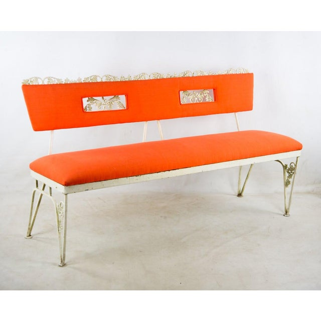Add a pop of color to your sun room with these Hollywood Regency orange and white benches. The orange is vibrant and fun...