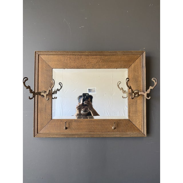 19th century oak mirror with hats hooks. Good used condition.Looks very classic! Dimensions: Mirror...