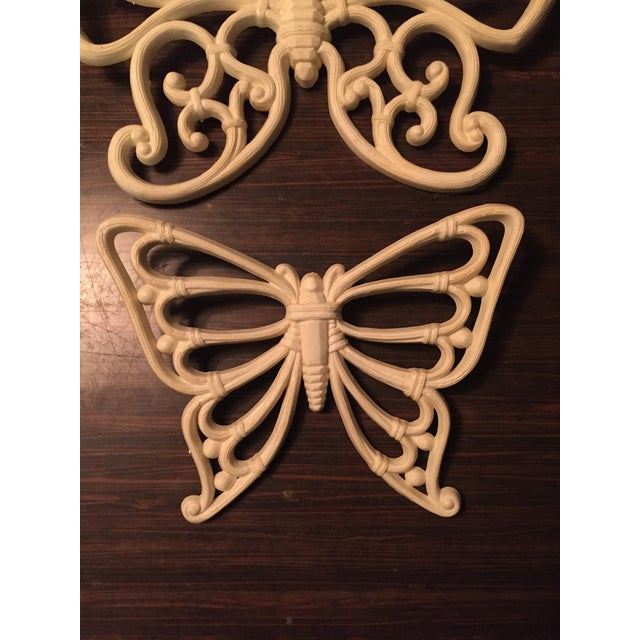 Vintage homco butterfly trio. These butterflies have the appearance of being carved from wood and are a cream / ivory...