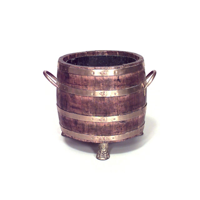 19th century English slat wood barrel shaped planter with brass trim and three claw feet (metal liner).