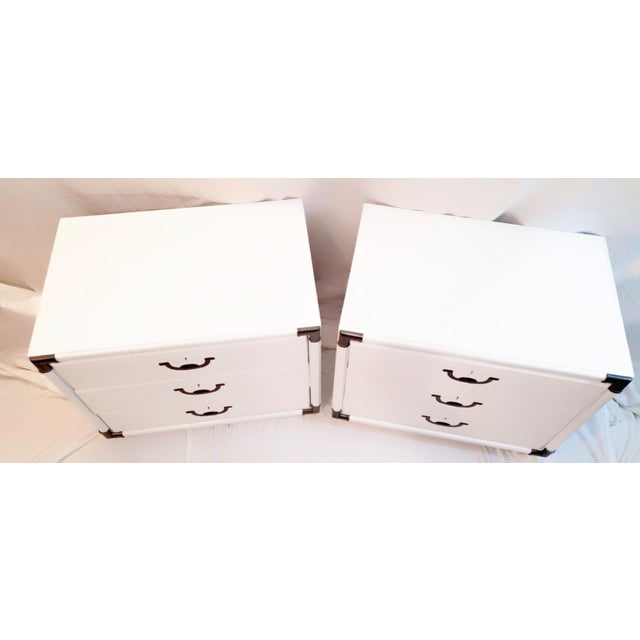 Professionally refinished in white lacquer. Each has three drawers that all work perfectly. The inside of these...