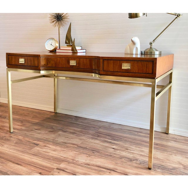 Elegant and rare vintage Drexel Consensus campaign writing desk. Gorgeous Ash wood combined with gleaming brass hardware...