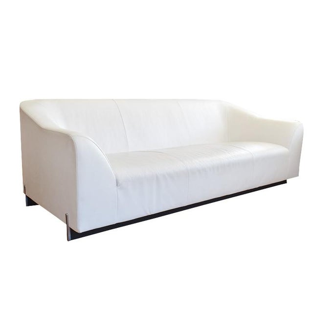 Beautiful long white leather sofa by Eric Jourdan for Ligne Roset. This beautiful sofa has a fantastic form. A tall back...
