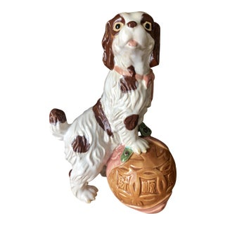 Staffordshire Style Ceramic Spaniel Statue With Chinoiserie Ball For Sale
