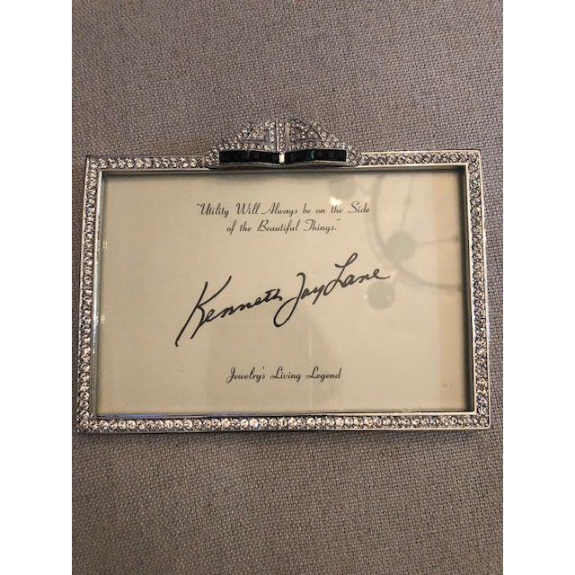 An exquisite picture frame inspired by classic jewelry from the Kenneth Jay Lane collection. It is artistically crafted...