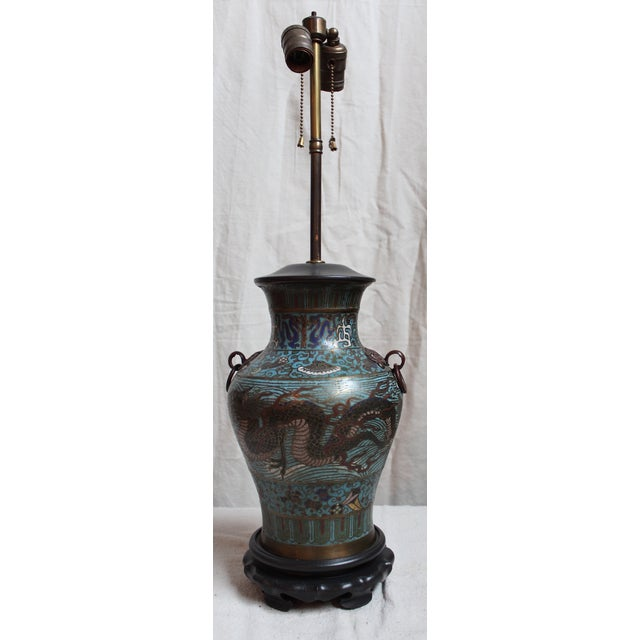 Beautiful early 20th C. champleve enameled urn mounted as a lamp. Original cluster but newer base and vase cap. May need...