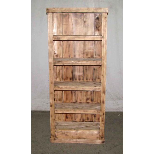 Simple rustic book case made from reclaimed wood.