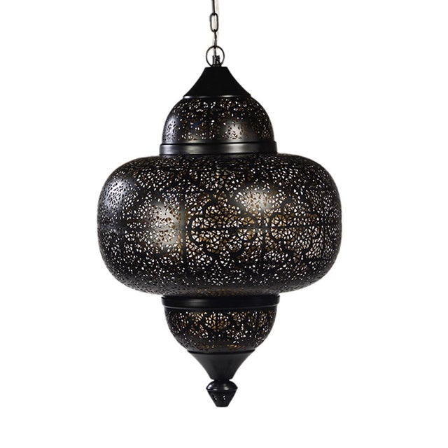 Perforated metal Kasbah lantern with intricate cut-out detail. This sultry dark metal lantern will look gorgeous in any...