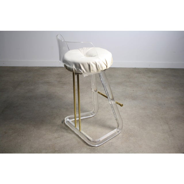This Lucite Bar Stool in the manner of Leon Frost is a must have for a design lover! The construction and lines are...