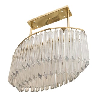 An Oval Chandelier in Brass and Glass Prisms by Venini For Sale