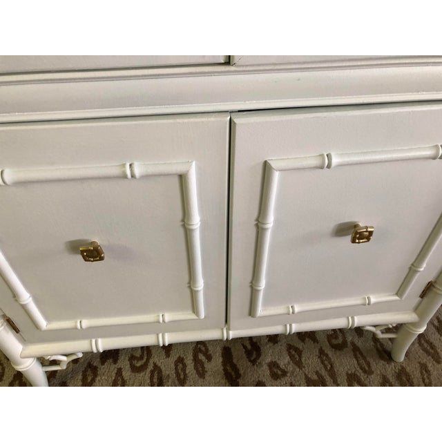 This gorgeous china cabinet has beautiful fretwork and has been artistically redesigned yo be a one of a kind focal point...