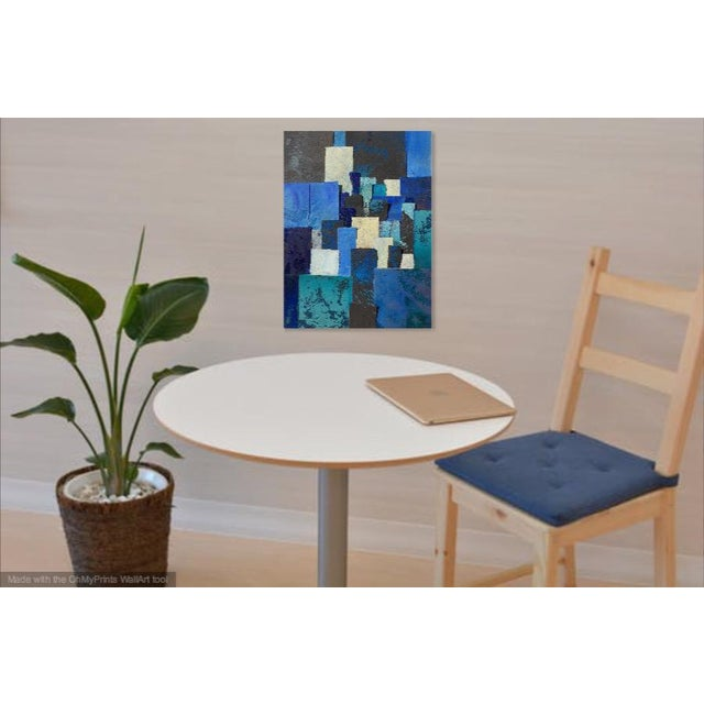 This beautiful piece of art is made with collage of paper in all kinds of blues. The paper is French BFK Rives that has...
