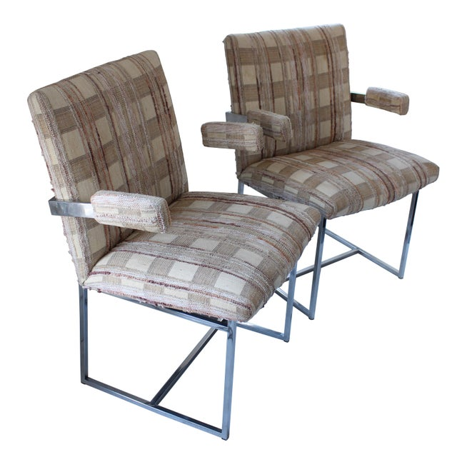 Fabulous chrome dining chairs with arms. Fashioned in the style of Milo Baughman, these extremely comfortable chairs are...