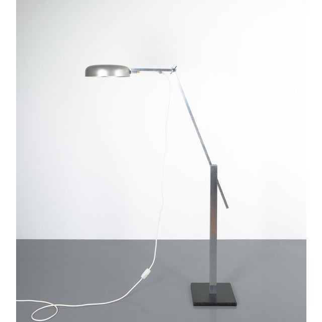 Articulate aluminum floor lamp by Schliephacke for Mewa, circa 1955. Elegant articulate floor light that be moved in all...