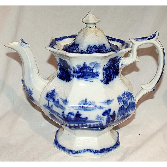 Staffordshire Hindustan-pattern flow-blue teapot, circa 1850. Lid knob reattached in decades past- very clean and usable...