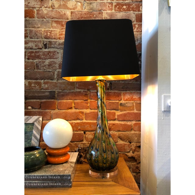 Gorgeous and unique yellow murano lamp with blue and green accents. Vintage Italian design with newly updated lucite base...