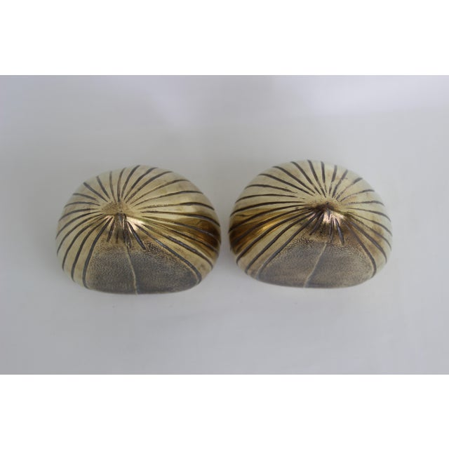 Ben Seibel Jenfred-Ware brass clam bookends. The pair was made in the USA in the 1950s. Great vintage condition... hollow...