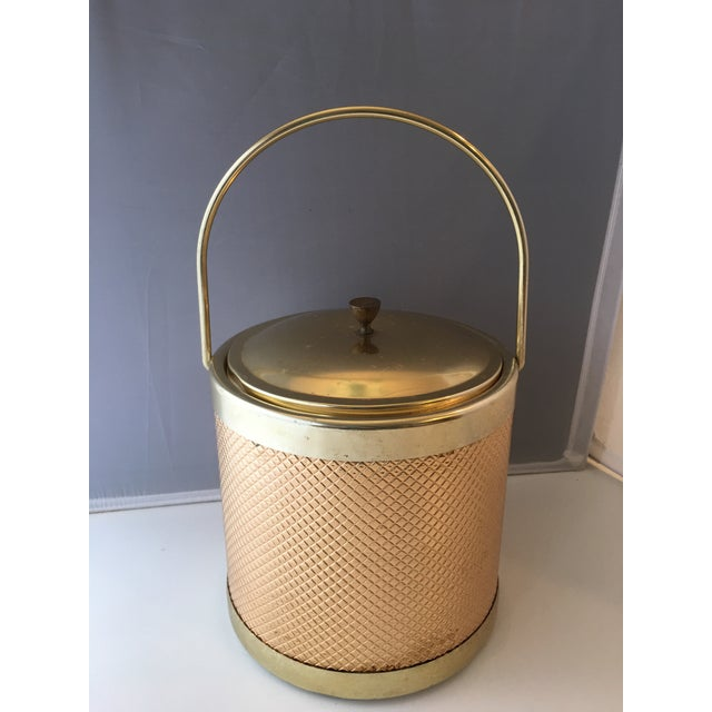 "Mid-century gold metal ice bucket. Lined and insulated, with removable lid. Marked ""made in Italy"" on base."
