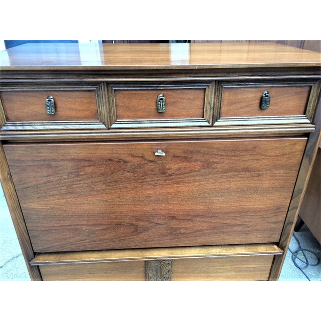Mid-century modern secretary/desk from the Mayan collection by Bassett. Circa 1960s. Made of walnut wood. Very usual in...