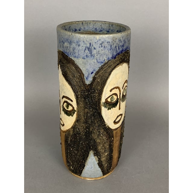 """Very unique mid-century sgraffito vase with 3 faces. Measures 10"""" high and 4.25"""" wide. Marked on the bottom, as shown."""
