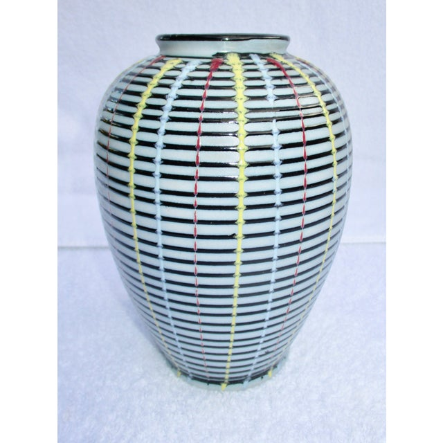 Japanese studio vase in porcelain with 5 color glazes over sides. The interior is clean and the bottom is glazed in black....