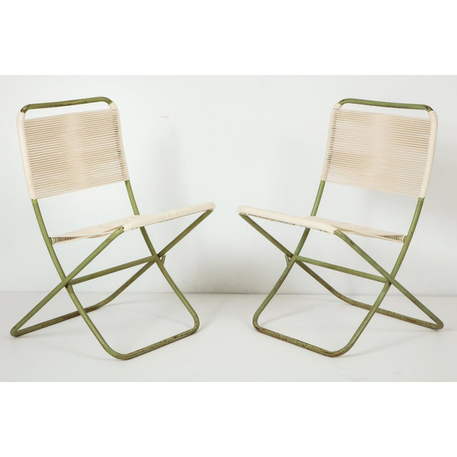 Exceedingly rare, sculpturally resonant Greta Grossman indoor/outdoor folding chairs, of painted tubular steel and cotton...