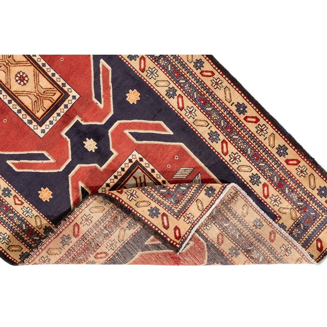 A hand-knotted vintage Persian rug with a geometric design. This piece has great detailing and colors. It would be the...