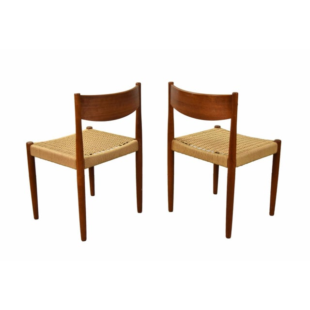 Magnificent pair of teak dining chairs by Poul Volther for Frem Rojle. Clean tapered legs with nicely shaped curved...