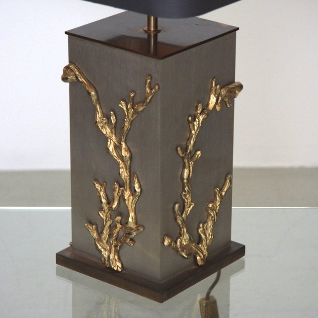 Very rare and elegant Maison Charles table lamp with massive bronze applications of algues or corails. The lamp is signed...
