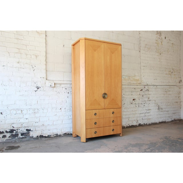 A rare and exceptional primavera armoire or wardrobe dresser by Baker Furniture. From the only collection of residential...