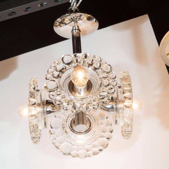 This sophisticated Mid-Century Modern chandelier was realized by the esteemed Austrian glass studio J.T. Kalmar, circa...