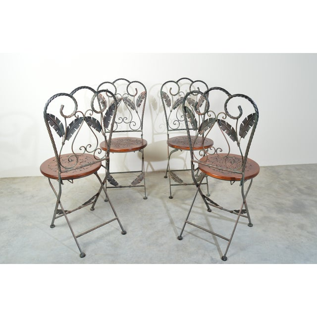 Safari themed French Bistro folding chairs having detailed metal frames with circular inlayed wood seats. Very ornate and...