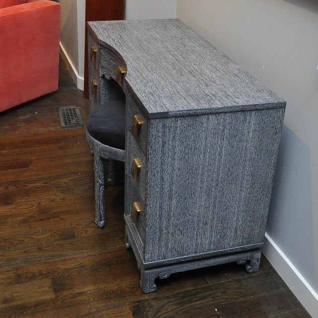 Well made grey cerused oak vanity with matching stool in black mohair. Seven drawers have brass greek key designed pulls.