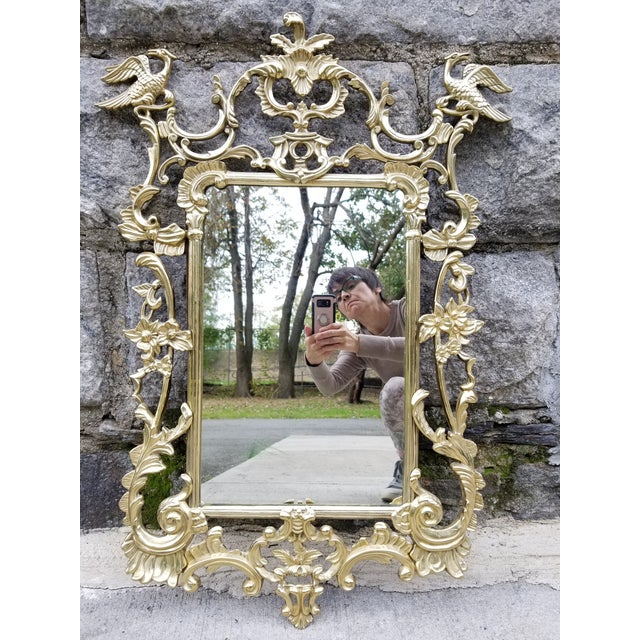 Stunning mid 20th century Chippendale style Ho Ho bird and flower motif mirror. This mirror is definitely a statement...