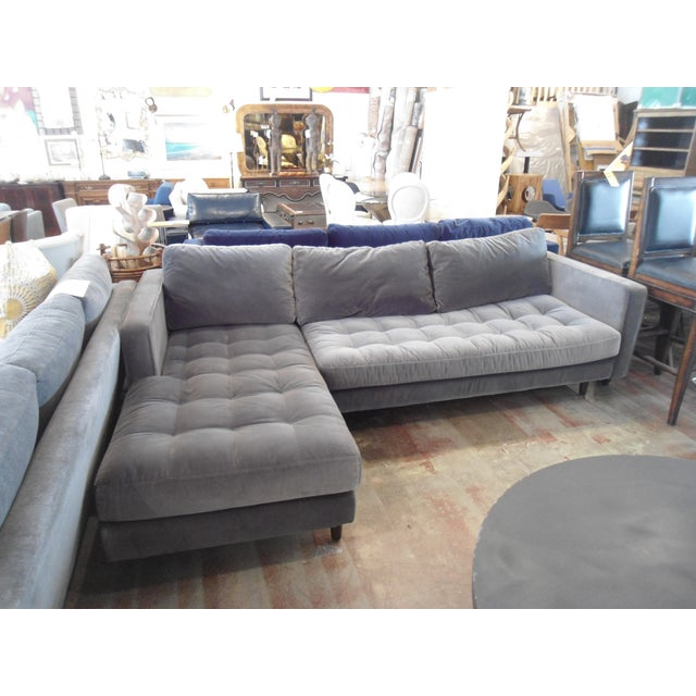 A comfortable dark gray velvet sectional with down filling. The surface is a little dusty, but everything can be cleaned....