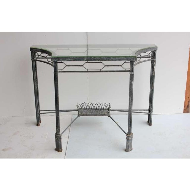 Modern style & metal base Demi-lune/console table with glass top. We have two tables available. Listed price is for one...