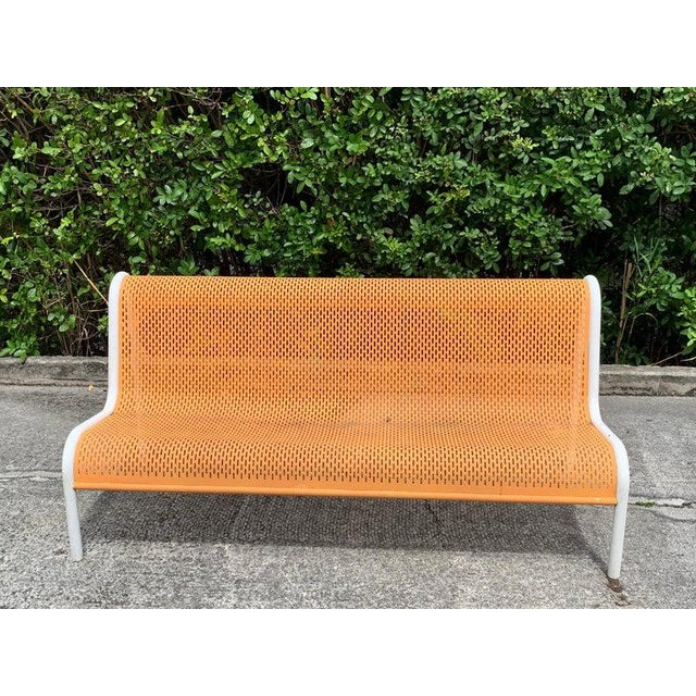 Miami modern wrought iron sculptural long bench, With flowing piereced back and seat rest, in vintage orange and white,...