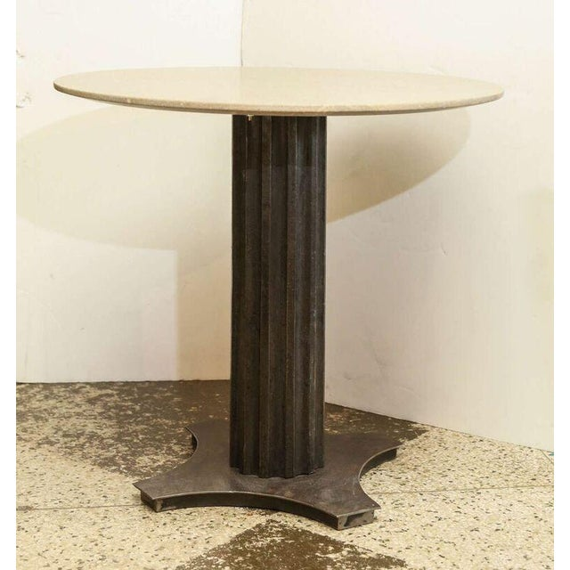 Iron table made with antique fluted iron column on a steel base and a new limestone top. Two tables are available at...