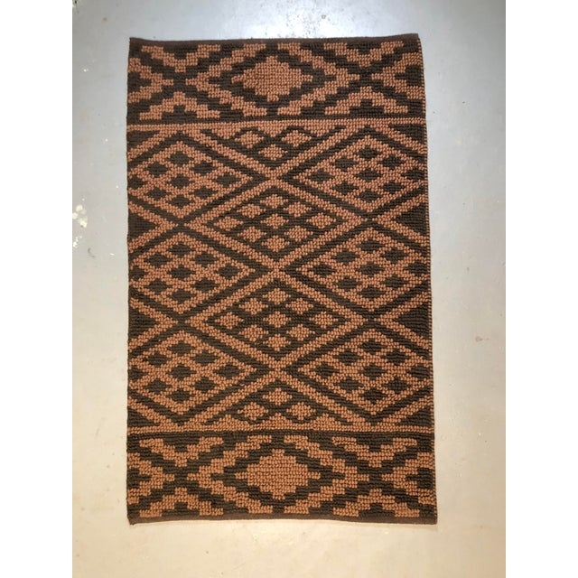 Great brown and tan heavy knit geometric rectangular rug.