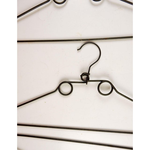 Set of 3 unusual heavy wire vintage coat hangers. Dimensions do not include hook portion, overall patina.