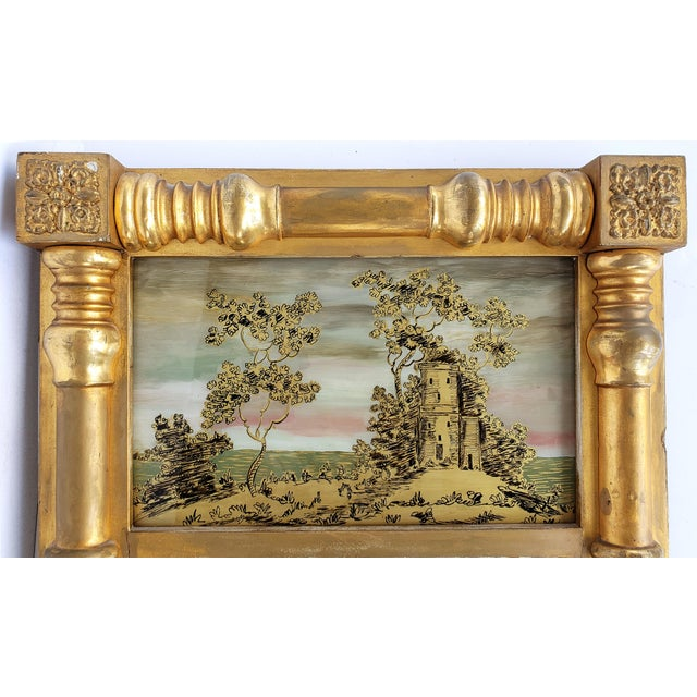 Offered for sale is a 19th-century Federal Reverse Painted Giltwood Tabernacle Trumeau Mirror. This antique mirror has a...
