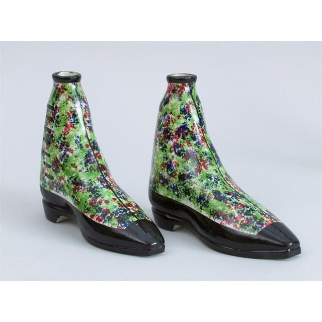 British pottery parlware sponged spirit flasks modeled in form of boots, Scottish, circa 1840-1850. The pair of unusual...