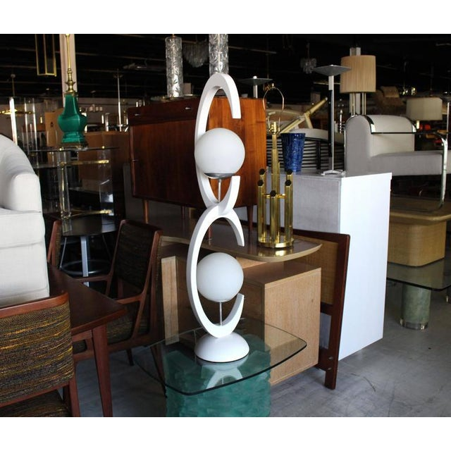 Very nice Mid-Century Modern white lacquer table lamp with frosted glass globes shades.