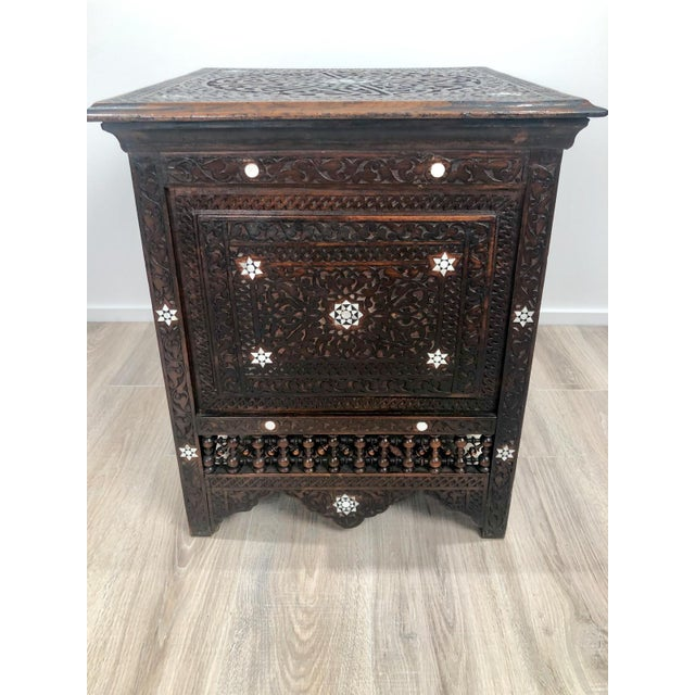 A Moroccan carved and inlaid square table, circa 1880